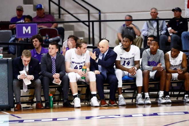 ACU assistant coach Brette Tanner talks to Clay Gayman (42) on the bench during a Wildcats game at Moody Coliseum. Tanner was named the program's 17th head coach on Wednesday, April 14, 2021.