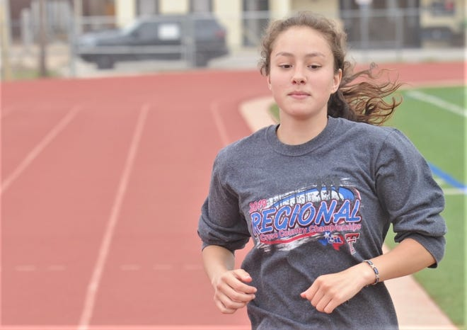 Cooper senior Simona Hamilton runs during practice Thursday at the Cooper track.