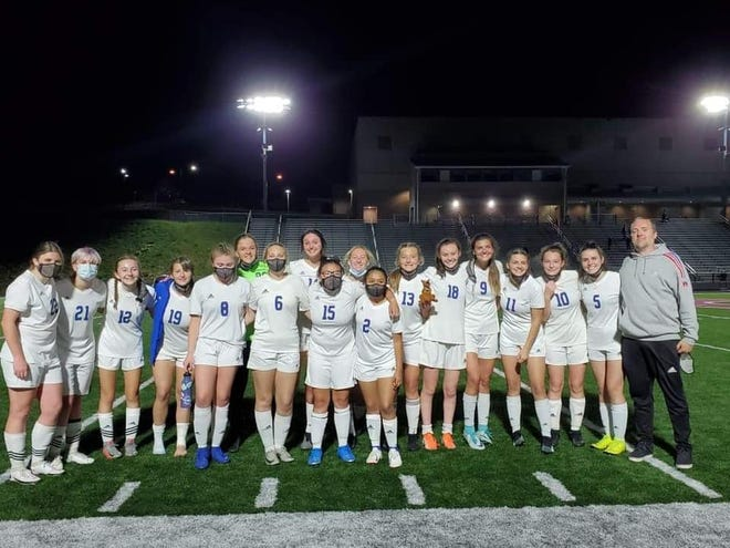 The Madison High girls soccer team poses for a photo following the team's 4-3 win at Owen on April 12.