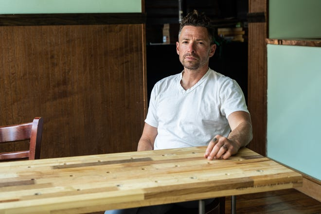 Jason Sessoms, owner of Table, poses at Table's new location on N Lexington Ave on April 14.