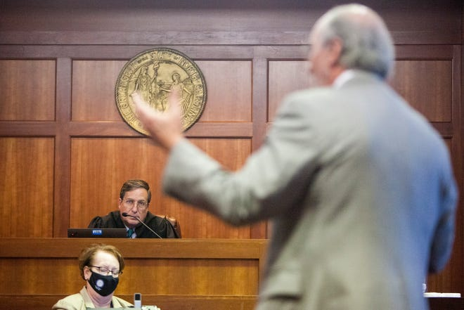 Judge Ervin listens as independent counsel James Cooney III makes closing statements during the removal hearing of District Attorney Greg Newman April 14, 2021.