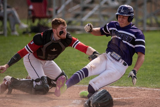 Marshall's Cooper Middleton tags Lakeview's Joel Metzger at the home plate on Tuesday, April 13, 2021 at Marshall High School.