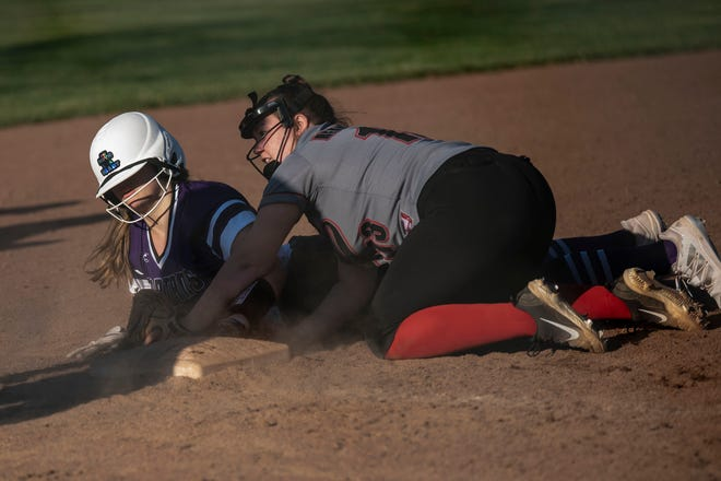 Marshall's Ashton Kaliz tags Lakeview's Peyton Russell at third base on Tuesday, April 13, 2021 at Marshall High School.