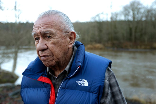 FILE - In this Jan. 13, 2014, file photo, Billy Frank Jr. poses for a photo near Frank's Landing on the Nisqually River in Nisqually.
