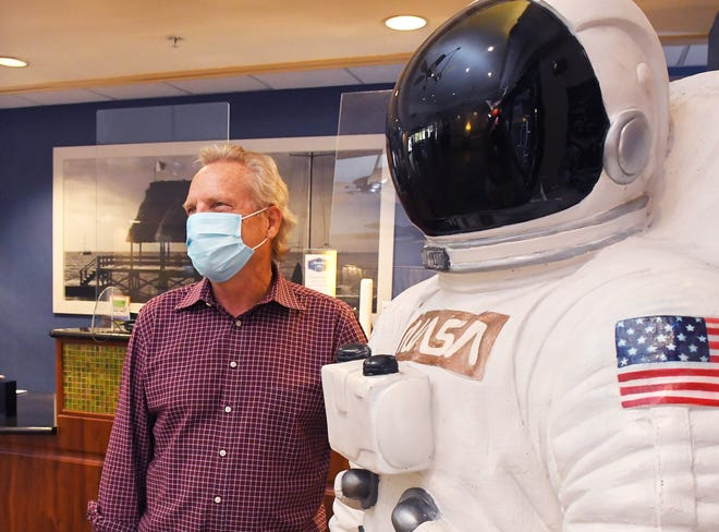 Tom Williamson, president of Cocoa Beach Area Hotel and Lodging Association, stands next to an astronaut mannequin at one of his company's hotels, the Hampton Inn in Cocoa Beach. Williamson said he expects Thursday's scheduled SpaceX Crew-2 launch to keep the momentum going for the local tourism industry, after a strong spring break.  - 8396855b 922b 4cc4 97a3 360d611894e6 Crewed Space Launch Boosts Local Businesses 1 - Space Coast tourism expects boost from SpaceX launch of astronauts