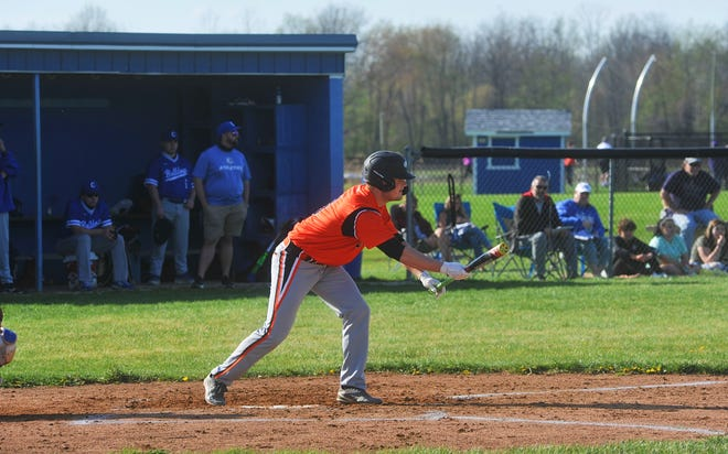 Lucas' Lane Harper shows bunt to the pitcher.