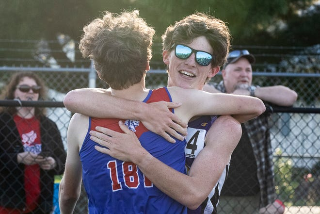 Unioto's Clayton Lynch hugs Northwestern's Kailan Marshall after their 1600 race at the Raidiger Track Invitational on April 13, 2021. Lynch won the race with a time of 4:43.05.