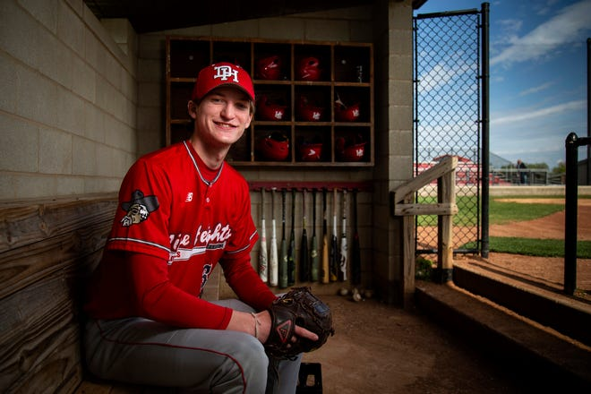 Dixie Heights pitcher Walker Smallwood waits in the home dugout before a game against Simon Kenton at Dixie Heights High School in Fort Mitchell. Smallwood was diagnosed with a rare form of bone cancer, one day before the start of his sophomore year in 2018.