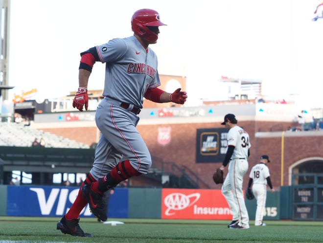 Apr 13, 2021; San Francisco, California, USA; Cincinnati Reds first baseman Joey Votto (19) jogs home on a two run home run against San Francisco Giants starting pitcher Kevin Gausman (34) during the first inning at Oracle Park.