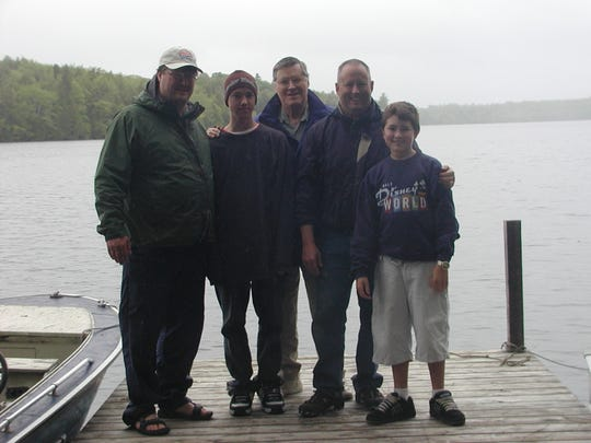 Gary Marple with his sons and grandsons on a fishing trip.