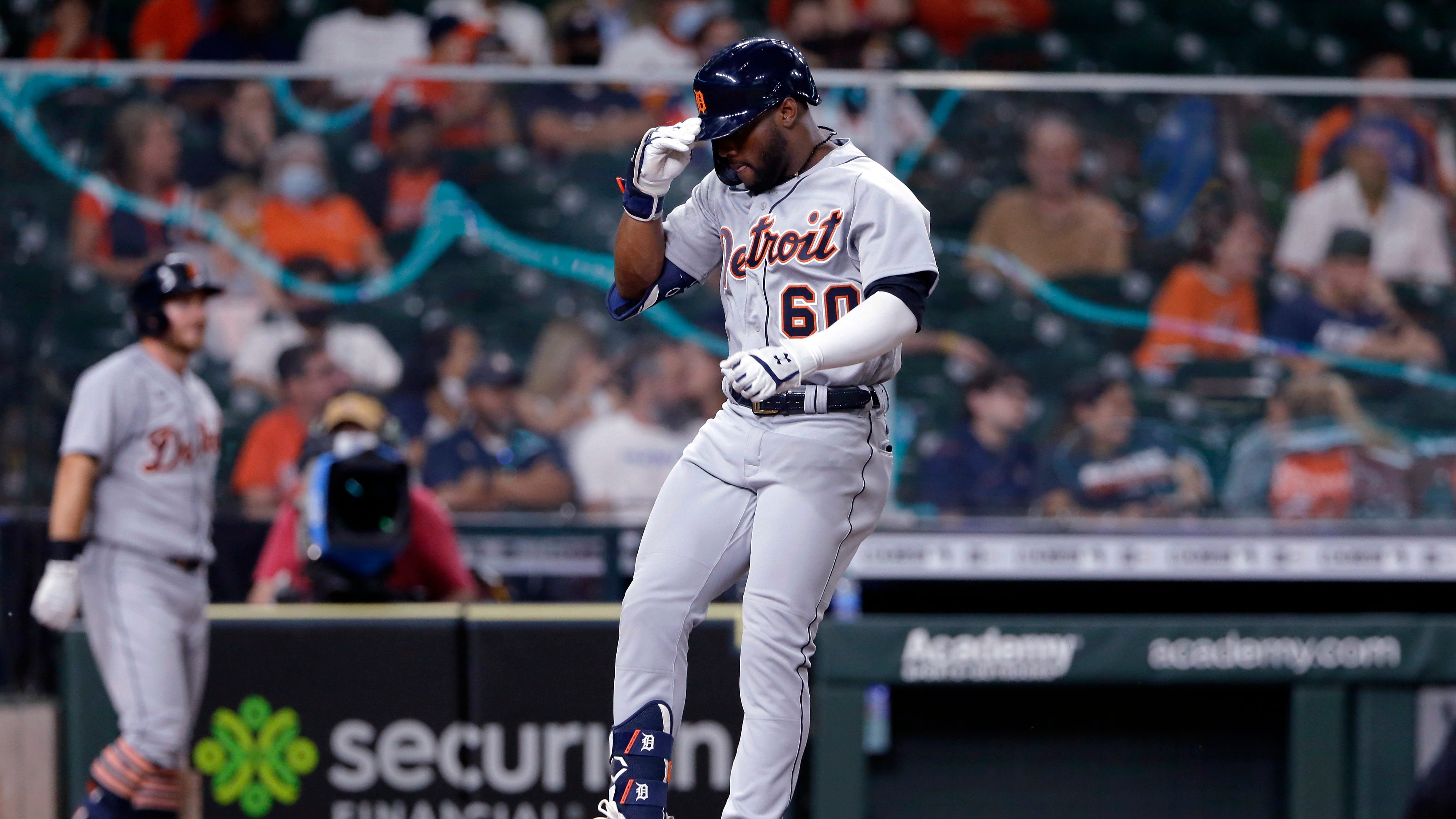 Detroit Tigers' Akil Baddoo (60) jumps onto home plate as he scores on his home run during the third inning of the team's baseball game against the Houston Astros Tuesday, April 13, 2021, in Houston.