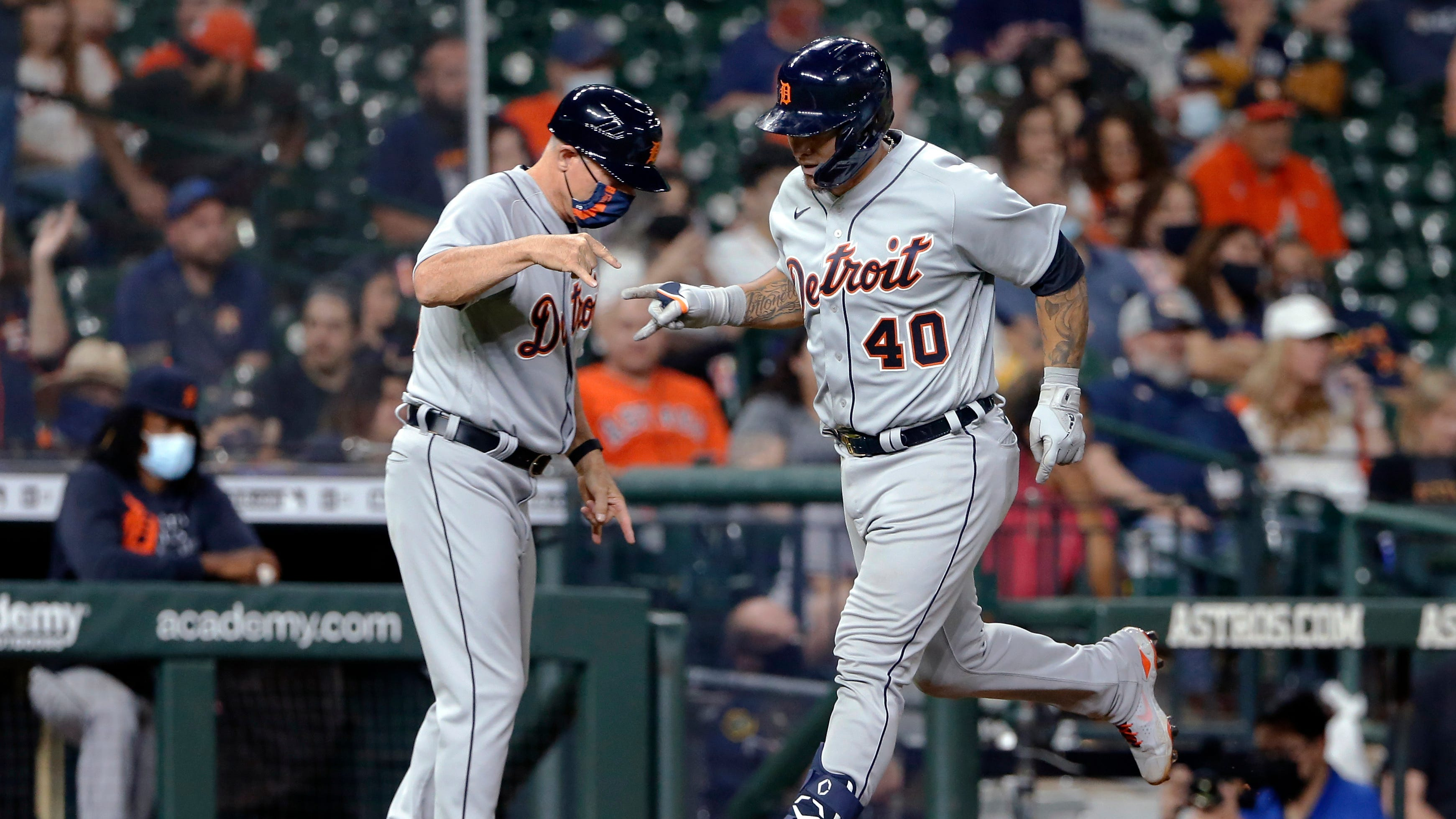 Detroit Tigers third base coach Chip Hale, left, celebrates with Wilson Ramos (40), who had hit a two-run home run against the Houston Astros during the fifth inning of a baseball game Tuesday, April 13, 2021, in Houston.