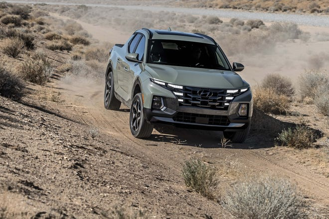 The 2022 Hyundai Santa Cruz is a cross between SUV and pickup. It rides on a unibody - not ladder-frame - and sports a more raked windshield and c-pillar.