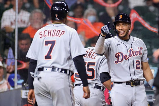 Victor Reyes #22 of the Detroit Tigers reacts with Jonathan Schoop #7 during the fourth inning against the Houston Astros at Minute Maid Park on April 13, 2021 in Houston, Texas.