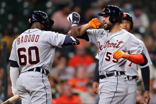 Renato Nunez #55 of the Detroit Tigers celebrates with Akil Baddoo #60 after hitting a home run during the fourth inning against the Houston Astros at Minute Maid Park on April 13, 2021 in Houston, Texas.