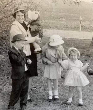 The late Sue A. Glasco poses with her son (left), Ragin' Cajuns softball Gerry Glasco, and his three sisters at home in an undated family photo.
