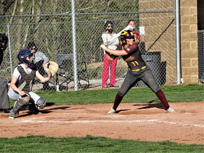 Berne Union sophomore Baylee Mirgon gets set to hit one of her two doubles against Logan in a non-conference game Tuesday. The Rockets suffered their first loss of the season, falling 2-1.