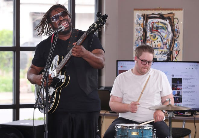 Vincent Fews, left, lead singer of Soul River Brown, the Foundation Band performed during the Feast event at Chef's Space in Louisville, Ky. on Apr. 13, 2021.