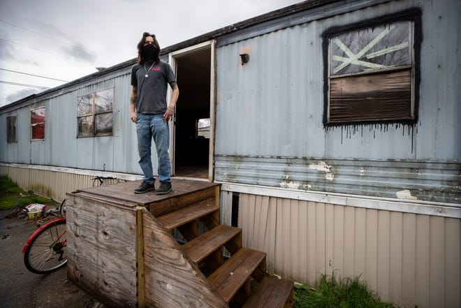 Residents of the North Fork Mobile Home Park have until April 30 to vacate the property on land that has been slated for development in Morehead, Kentucky. Eric Bailey looks out from the porch of his trailer, which is too old to be moved. Bailey is being forced to abandon his home. April 14, 2020