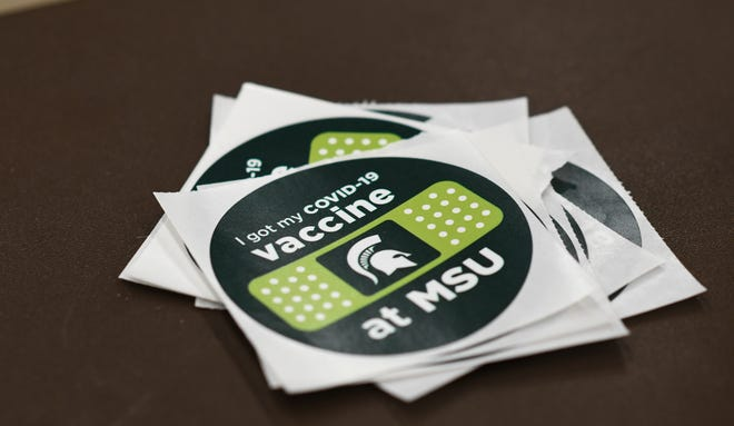 A stack of stickers seen at the student COVID-19 vaccination site at the MSU Pavilion for Agriculture and Livestock Education, Wednesday, April 14, 2021.
