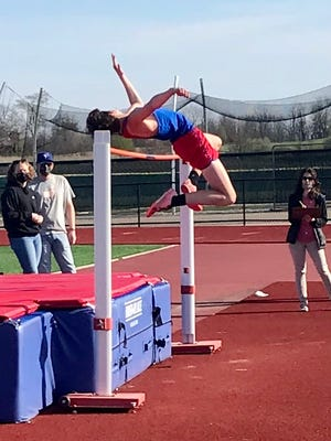 Joel Roberts of Highland competes in the boys high jump during a home tri-meet last week.