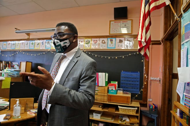 Keith Posley, superintendent of Milwaukee Public Schools, drops in on a classroom to say hello to students at Fernwood Montessori School on Wednesday.