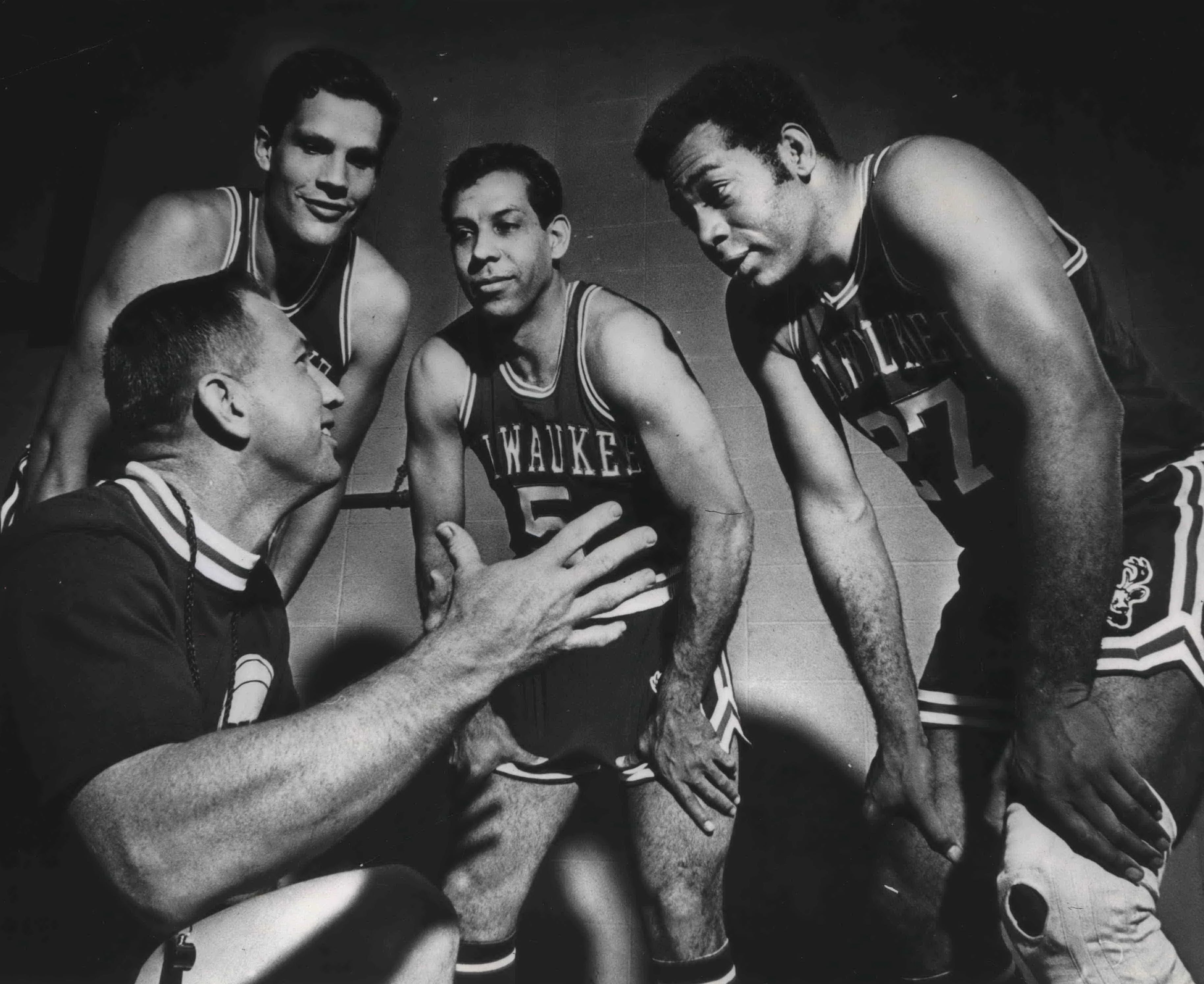 Coach Larry Costello, kneeling, talks with, from left, Fred Hetzel, Guy Rodgers and Wayne Embry as the Milwaukee Bucks opened training camp in Milton.