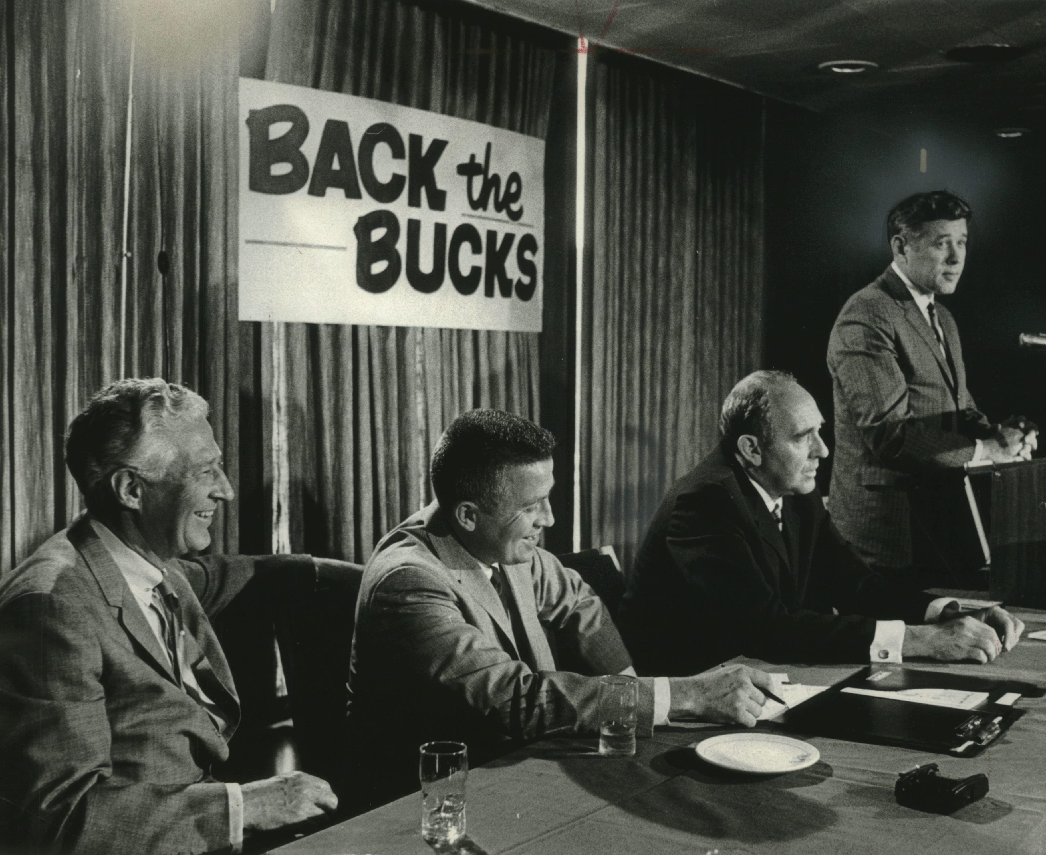 Milwaukee Mayor Henry Maier speaks as the Milwaukee Bucks open their season-ticket drive. Also at the table, from left, are Gov. Warren Knowles, Bucks general manager John Erickson and Bucks president Ray Patterson.