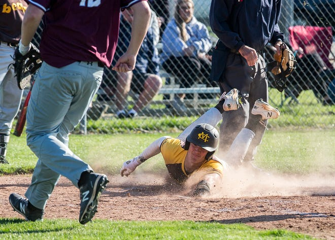 FILE -- Monroe Central's Aidyn Coffey slides into home during a game against Wes-Del faces at Wes-Del High School Tuesday, April 13, 2021.