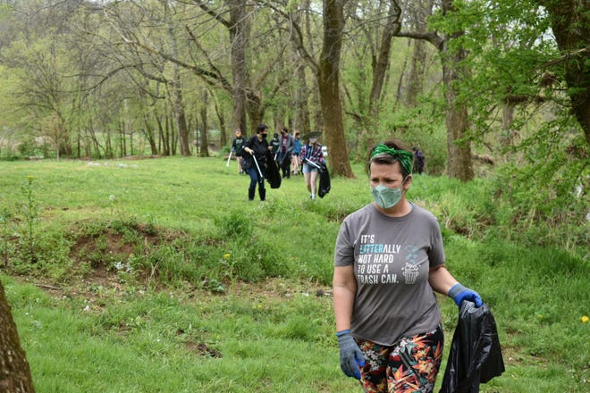 Volunteers removed tires and trash from land along the Red River.
