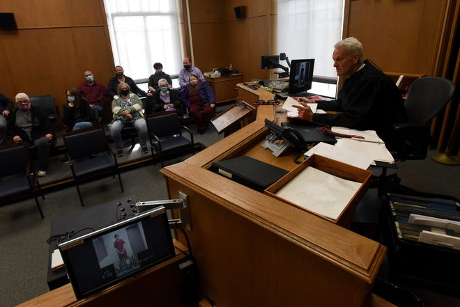 Judge David Branstool sentences Keegan Mummey, appearing via video in court, to 28-years to life in prison as the family of Isabella Barnes comforts each other. Mummey plead guilty to the aggravated murder charge in theÊ2019 shooting death of the 12-year-old Newark girl.
