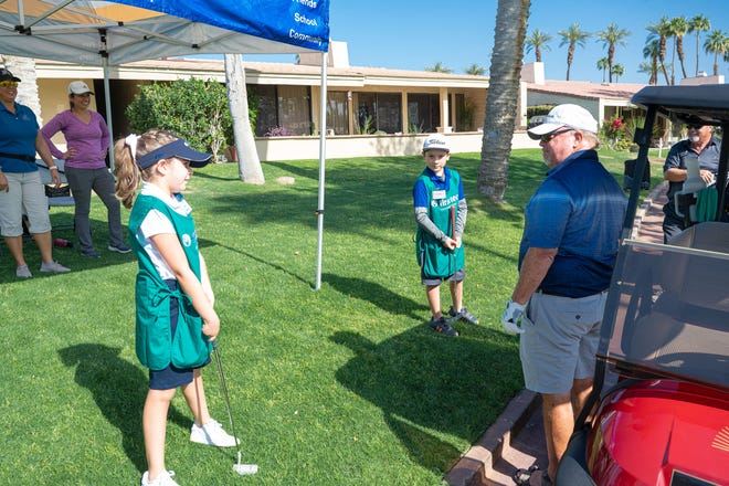 Members of the First Tee of the Coachella Valley acted as surrogate putters for golfers in a fundraising tournament at Desert Horizons Country Club in Indian Wells this week.