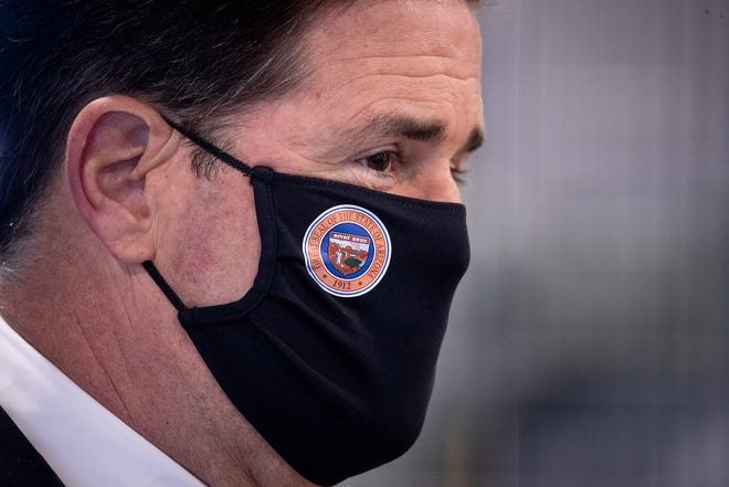 Gov. Doug Ducey during a news conference on March 31, 2021, in Coolidge, Arizona.