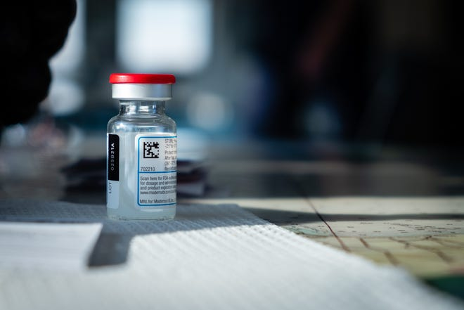 A vial of a COVID-19 vaccine sits on a table during a clinic Wednesday, April 14, 2021, at the Great Lakes Maritime Center in Port Huron.