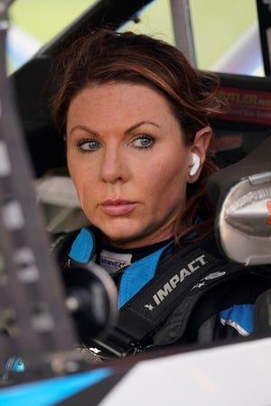 Jennifer Jo Cobb prepares for NASCAR truck qualifying at Daytona International Speedway, Friday, Feb. 12, 2021, in Daytona Beach, Fla. (AP Photo/John Raoux)