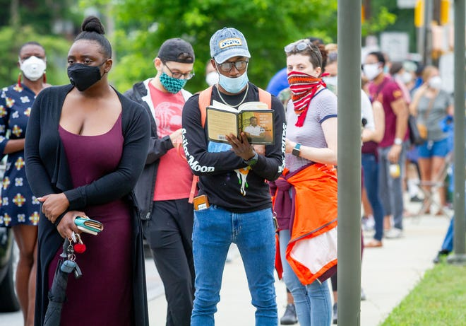 Voters wait in a long line that stretched around the Metropolitan Library on Tuesday, June 9, 2020, in Atlanta. (Steve Schaefer/Atlanta Journal-Constitution/TNS)