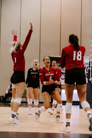 South Dakota setter Madison Jurgens (4) celebrates a point with her teammates against Missouri during the opening round of the NCAA Tournament in Omaha on April 14.