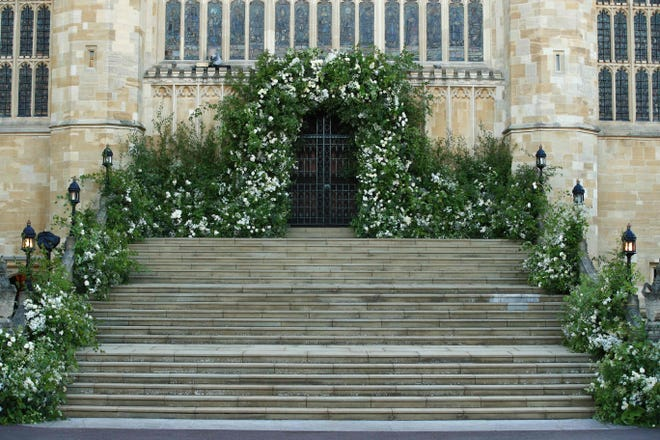 Flowers and foliage adorn the West door and steps of St George's Chapel for the wedding ceremony of Prince Harry and Meghan Markle at Windsor Castle, May 19, 2018.