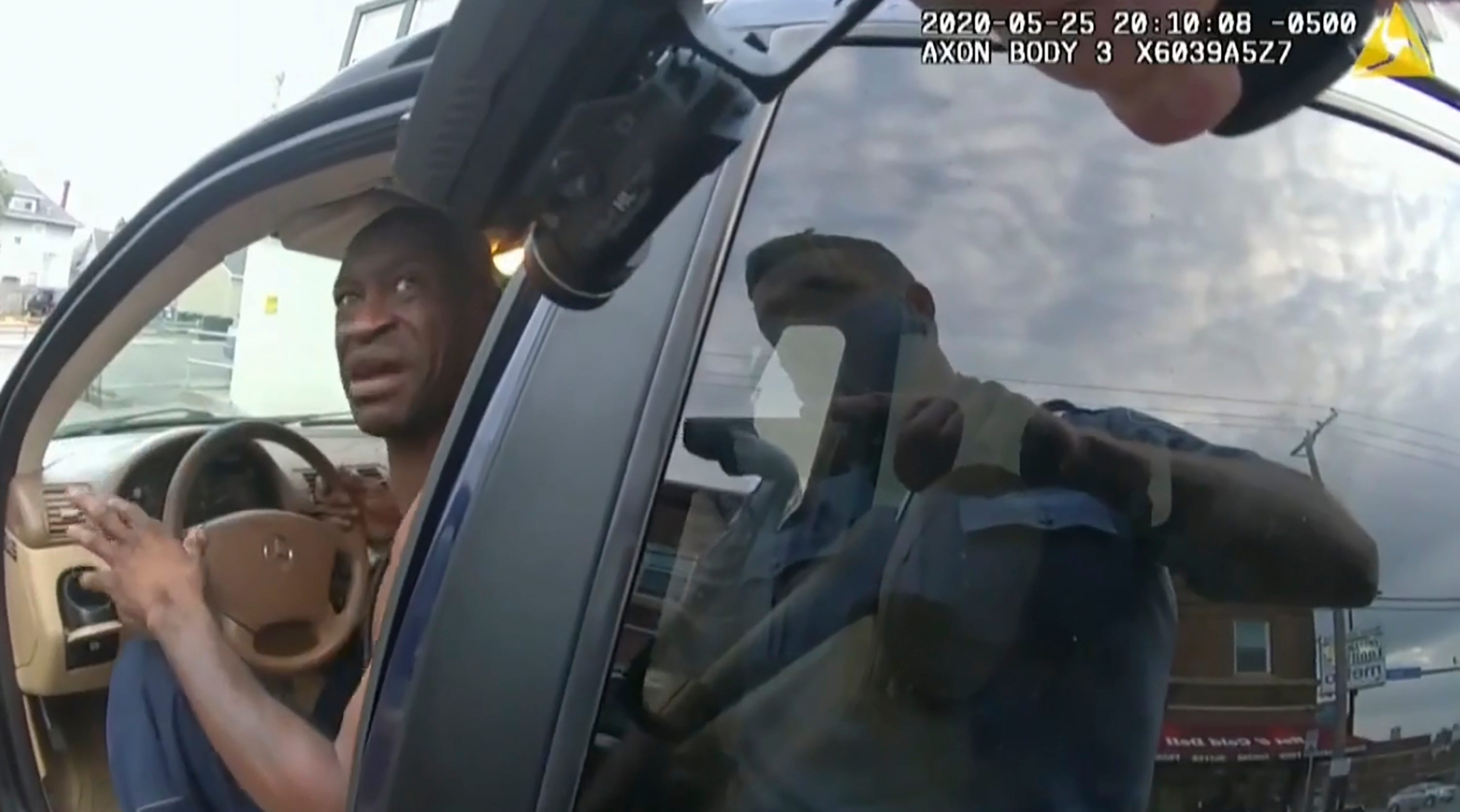 In this image from police body cam video, a Minneapolis police officer approaches George Floyd with a gun drawn, on May 25, 2020, outside Cup Foods in Minneapolis, as it is shown Wednesday, March 31, 2021, in the trial of former Minneapolis police Officer Derek Chauvin, in Floyd's death, at the Hennepin County Courthouse in Minneapolis.