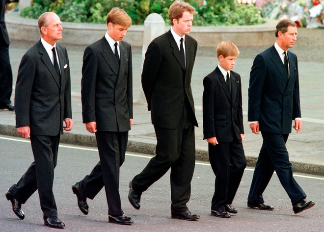 Prince Philip, Prince William, Charles Earl Spencer, Prince Harry and Prince Charles walk outside Westminster Abbey behind the coffin during the funeral procession for Princess Diana on Sept. 6, 1997.