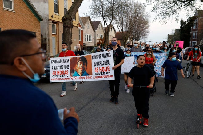 Members of Chicago's Little Village Community Council march on Tuesday, April 6, 2021 to protest against the death of 13-year-old Adam Toledo, who was shot by a Chicago Police officer at about 2 a.m. on March 29 in an alley west of the 2300 block of South Sawyer Avenue near Farragut Career Academy High School.