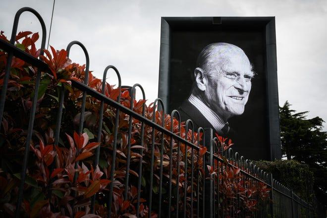 A digital billboard displays a portrait of Prince Philip, Duke of Edinburgh, who died April 9 at age 99 at Windsor Castle.