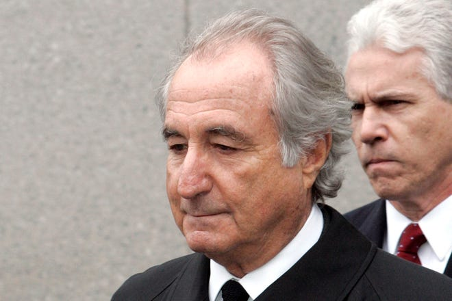 In this March 10, 2009, file photo, former financier Bernie Madoff leaves federal court in Manhattan, in New York. Madoff, the financier who pleaded guilty to orchestrating the largest Ponzi scheme in history, has died in prison, a person familiar with the matter tells The Associated Press.