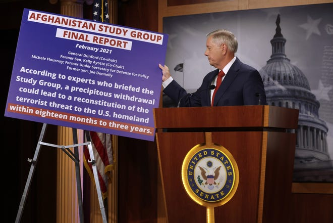 WASHINGTON, DC - APRIL 14: U.S. Sen. Lindsey Graham (R-SC) holds a poster during a news conference in response to President Joe Biden's withdrawal announcement from Afghanistan at the U.S. Capitol on April 14, 2021 in Washington, DC. President Biden announced that he would withdraw all troops from Afghanistan by September 11, 2021, the 20th anniversary of the 9/11 terrorist attacks.