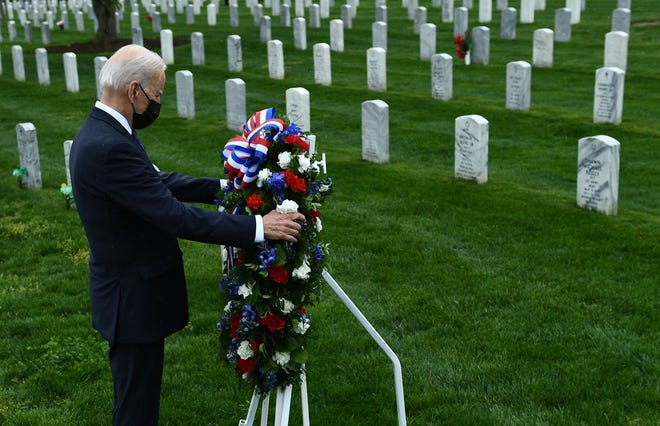 President Joe Biden honors fallen veterans of the Afghan war at Arlington National Cemetery in Arlington, Va. on April 14, 2021.