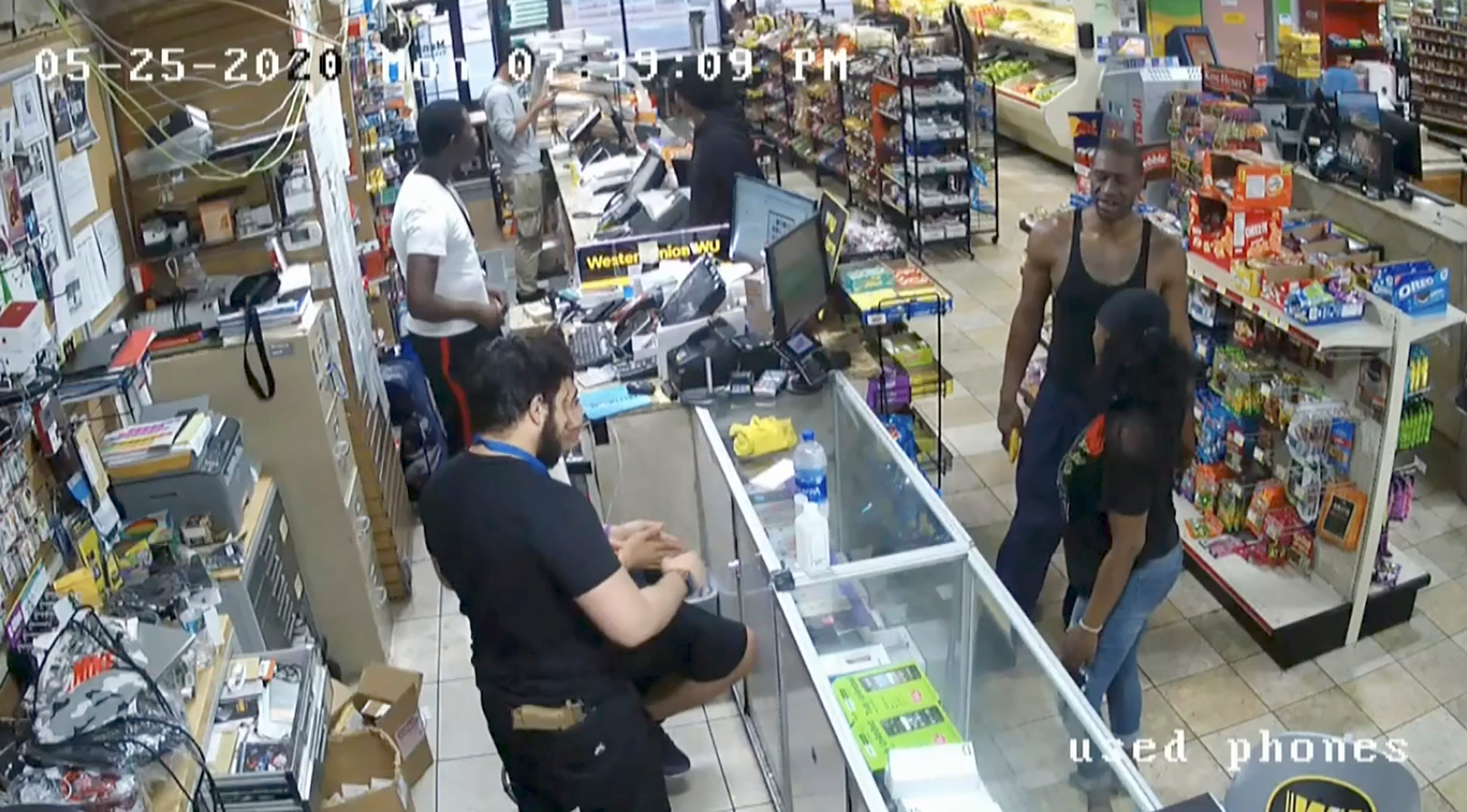 In this image from store video, George Floyd, right, is seen inside Cup Foods on May 25, 2020, in Minneapolis.  Former Minneapolis Police officer Derek Chauvin is on trial for the death of Floyd at the Hennepin County Courthouse in Minneapolis, Minn.