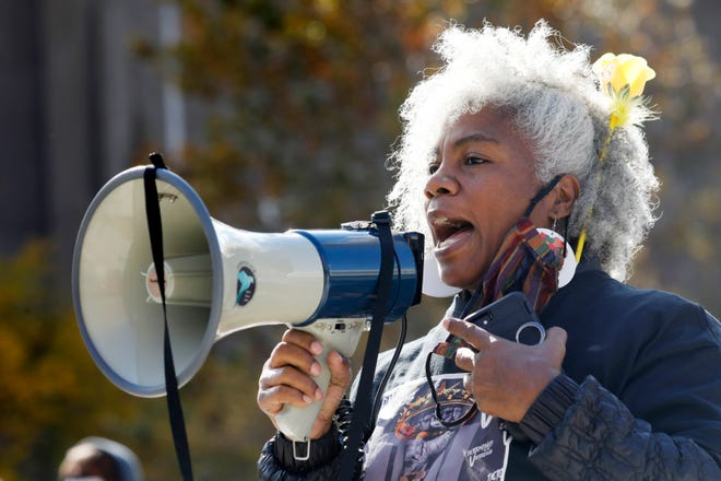 Activist Cariol Horne speaks during the WNY Women's March hosted by the WNY Peace Center in Niagara Square, Saturday, Oct. 17, 2020 in Buffalo, N.Y.  (Derek Gee/The Buffalo News via AP)