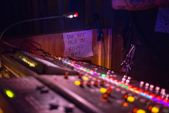"A ""do not talk to sound guy"" sign hangs next to the sound board at Barracuda during the 2018 SXSW Music Festival."