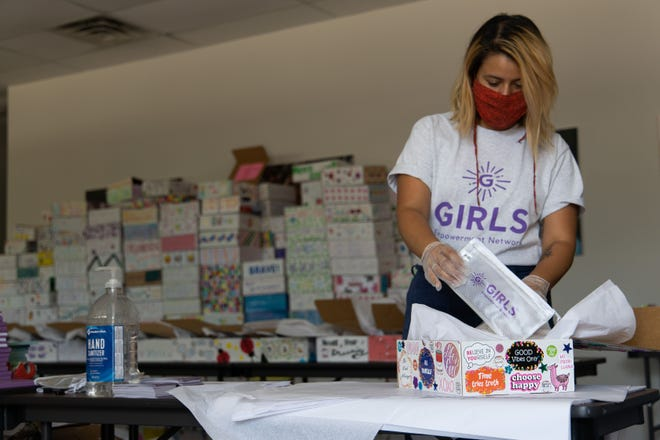 Chelsea Dean-Martinez assembles a Spark Kit that will go to one of the girls served by Girls Empowerment Network. Spark Kits were a big success during the pandemic, reaching more than 3,000 girls with hands-on programming they can do at home as well as a virtual component