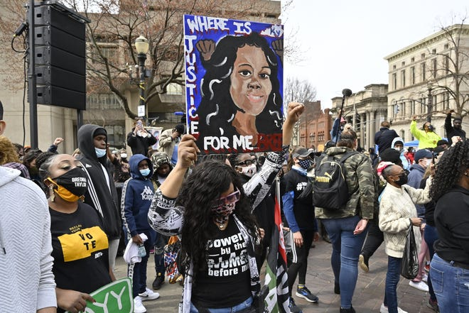 A protester holds up a painting of Breonna Taylor during a rally on March 13, the one-year anniversary of her death in 2020 in Louisville, Ky. On April 9, Gov. Andy Beshear signed a partial ban on no-knock warrants. [AP PHOTO/TIMOTHY D. EASLEY]